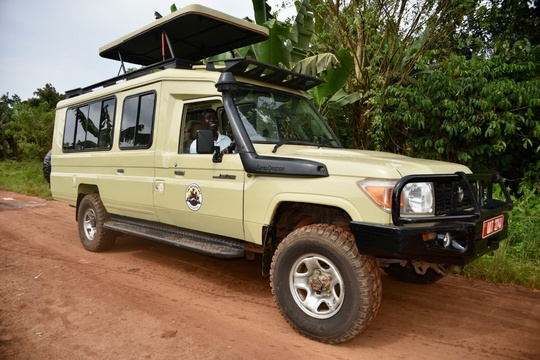 The Adventure Committee on safari in a Toyota Land Cruiser, Uganda