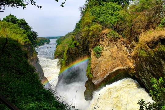 A rainbow hanging in the mist over Murchison Falls waterfall, Uganda