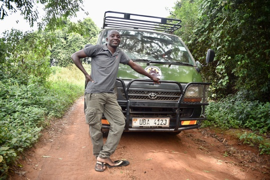 Tom, one of our driver guides with a Toyota Super Custom on safari in Uganda.